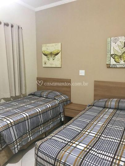 Um dos quartos da suite