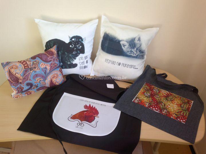 Almofadas, avental e bolsa