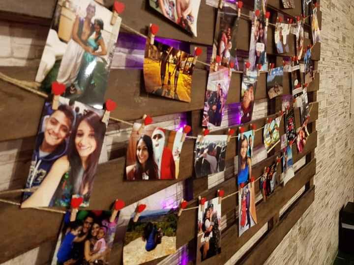 Mural com fotos dos 5 anos juntos
